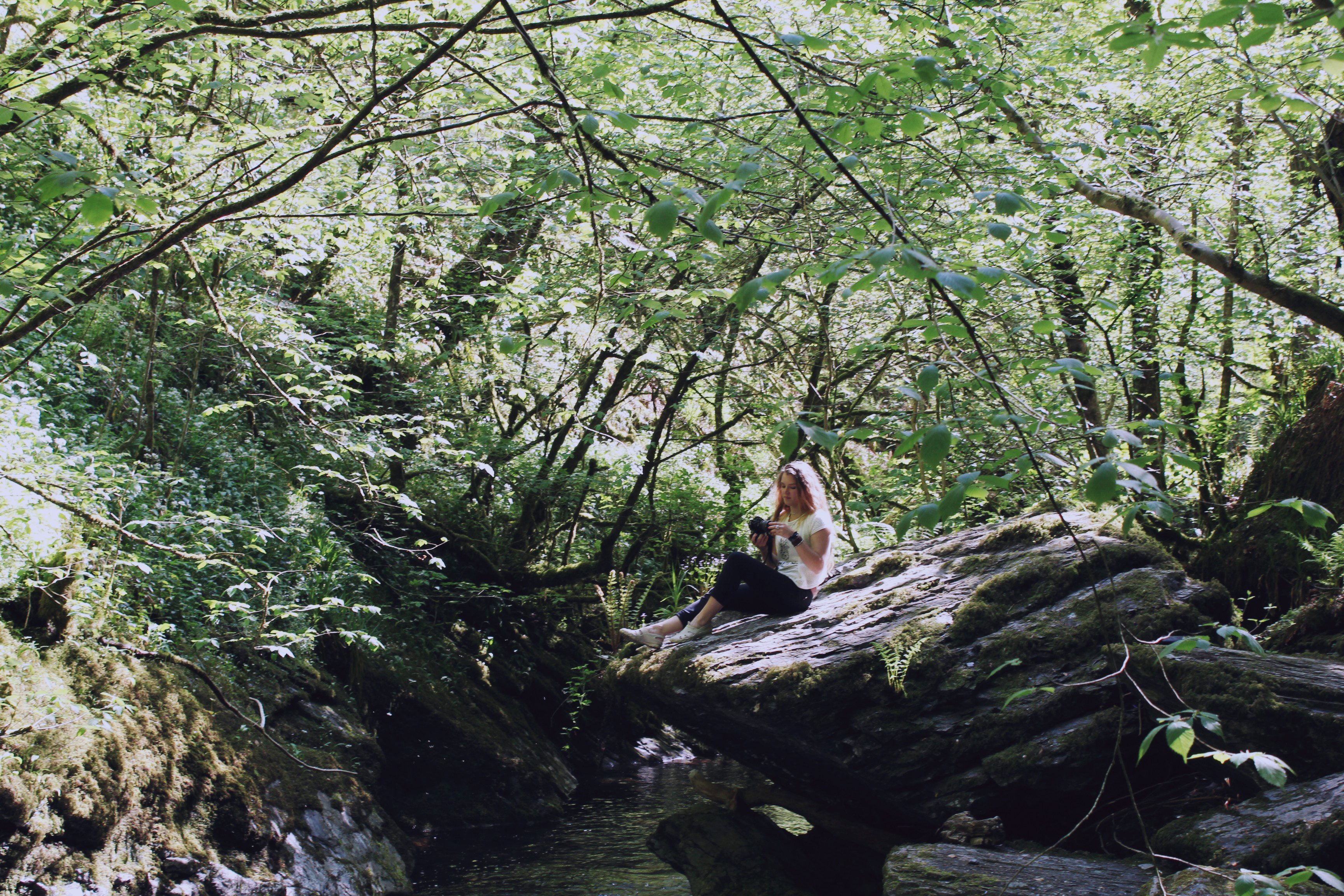 Sarah basking in the sun, on a rock in Lydford Gorge