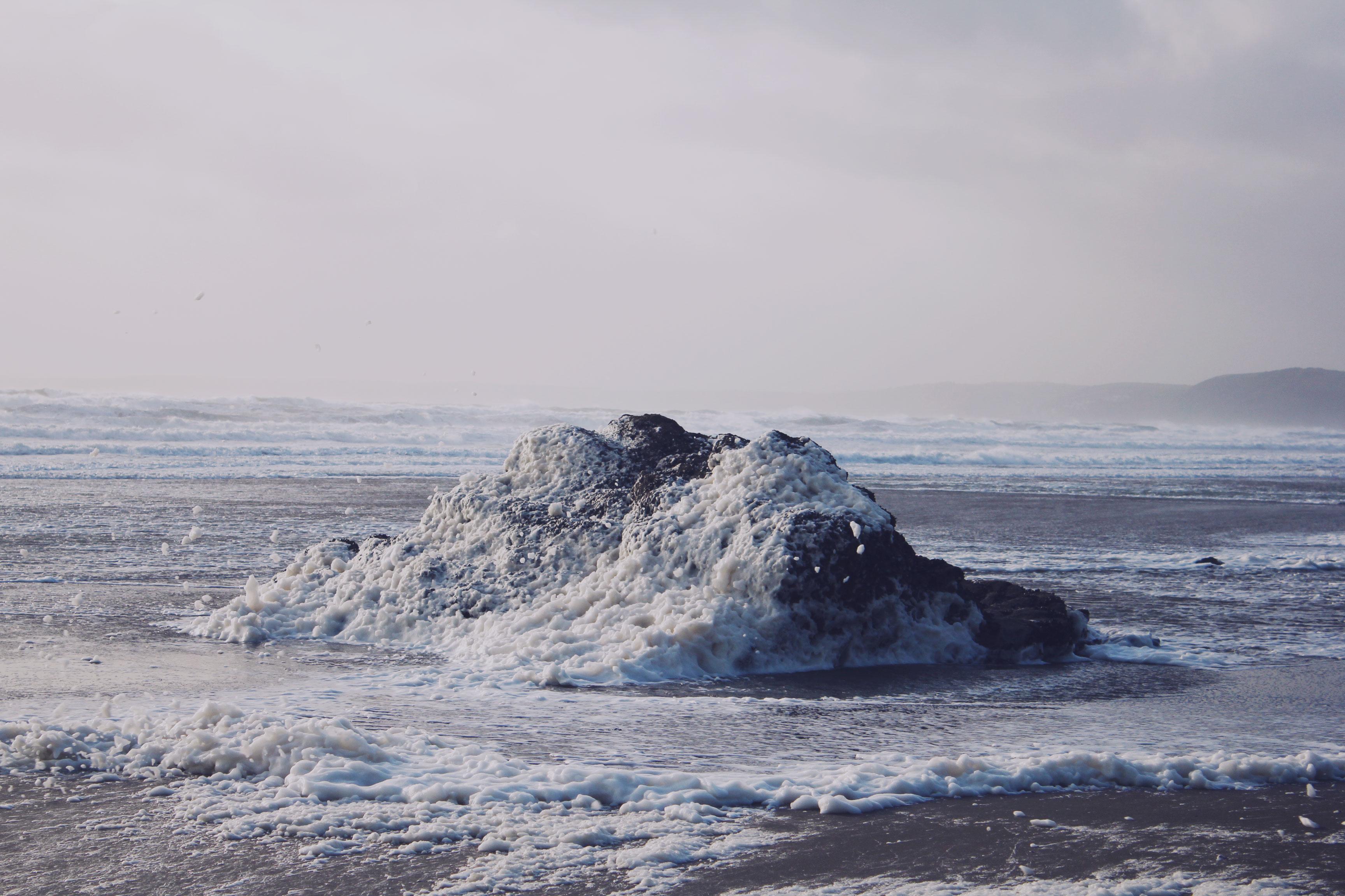 Lots of sea foam at Whitsand Bay, Cornwall