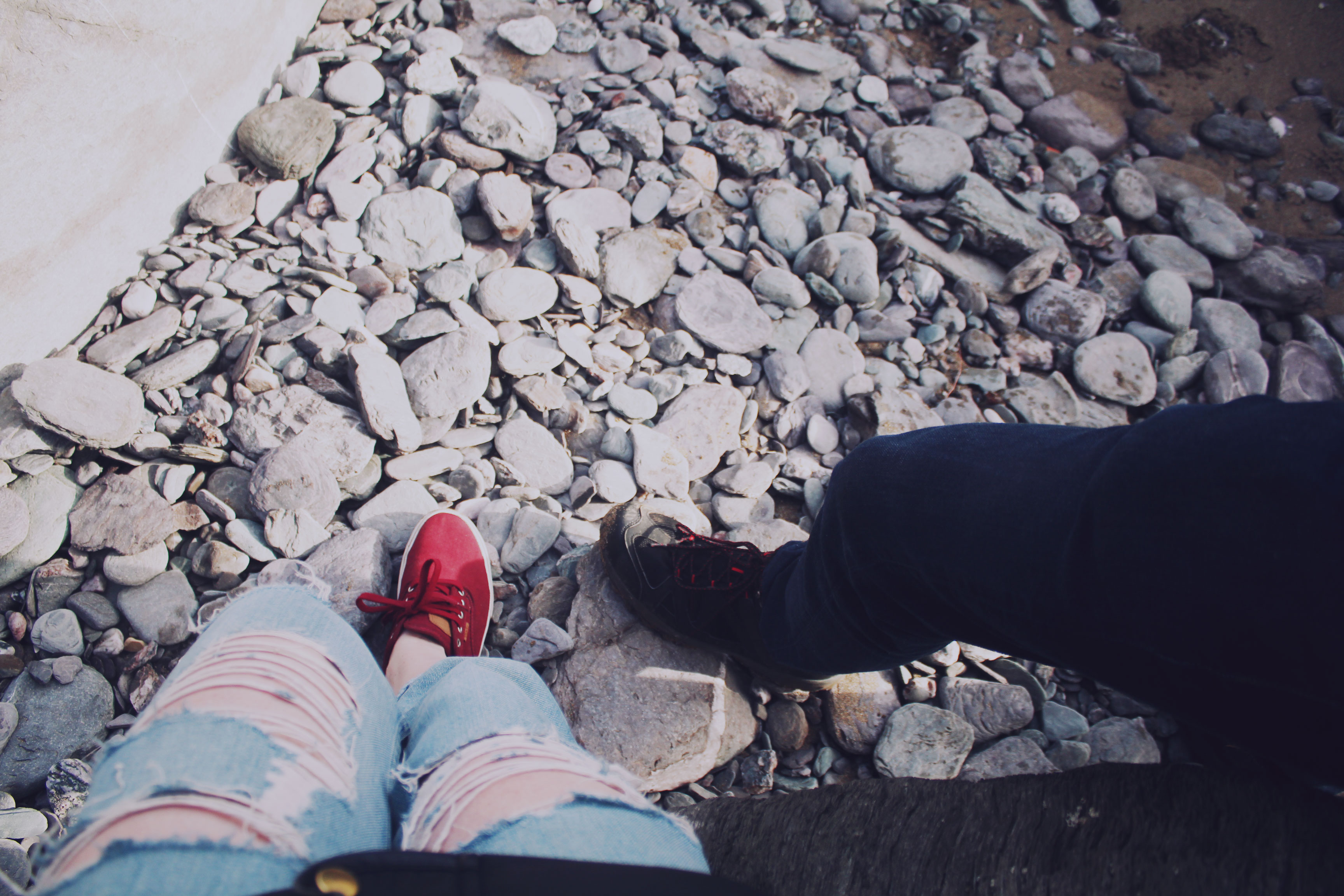 Red Vans and pebbles on the beach