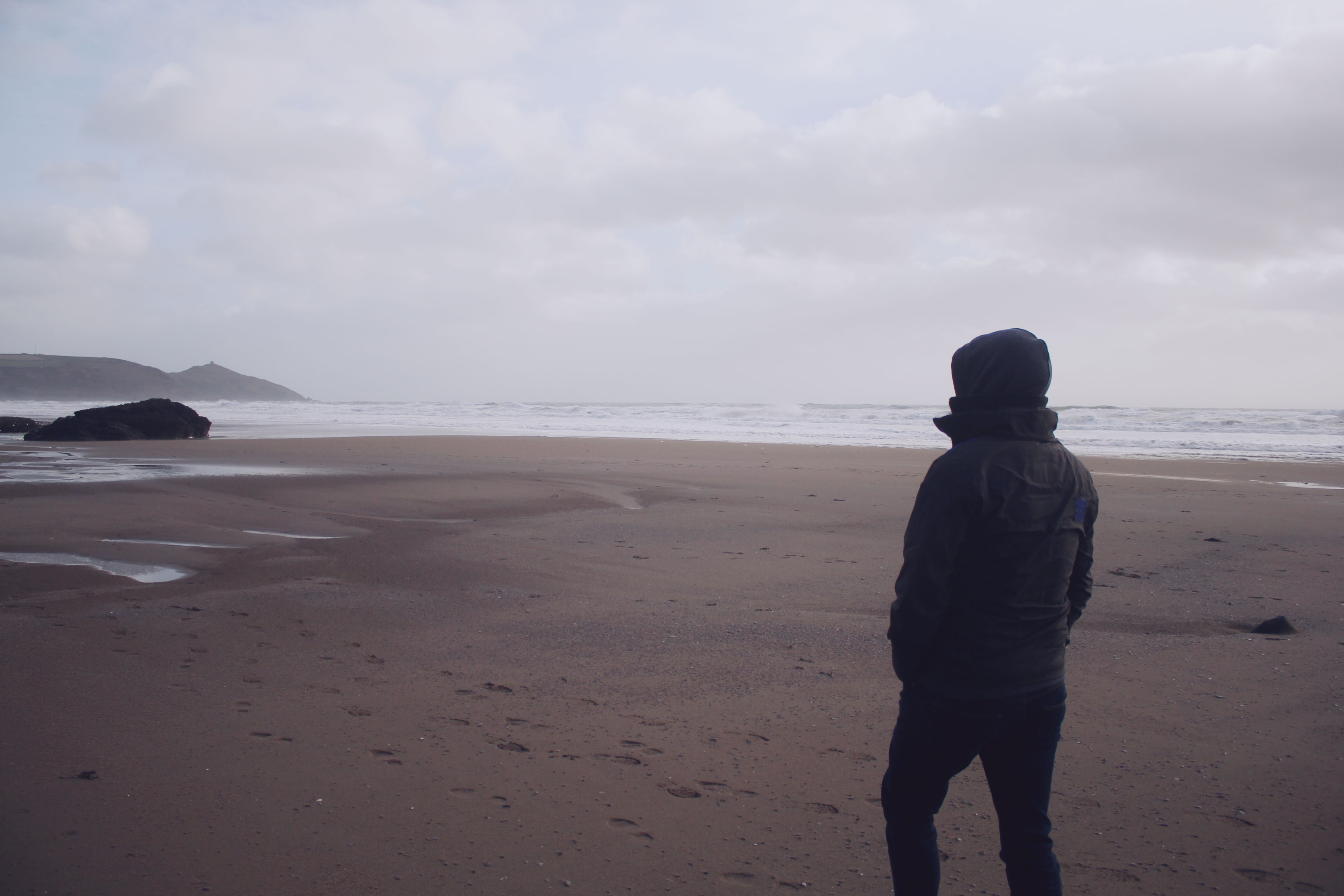 Ben walking on the beach at Whitsand Bay, Cornwall